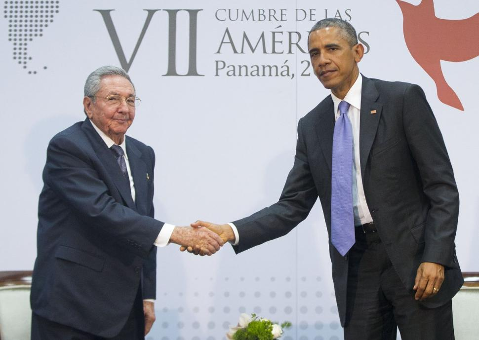President Obama shakes hands with Cuban President Raul Castro, announcing the end of a 53-year embargo.